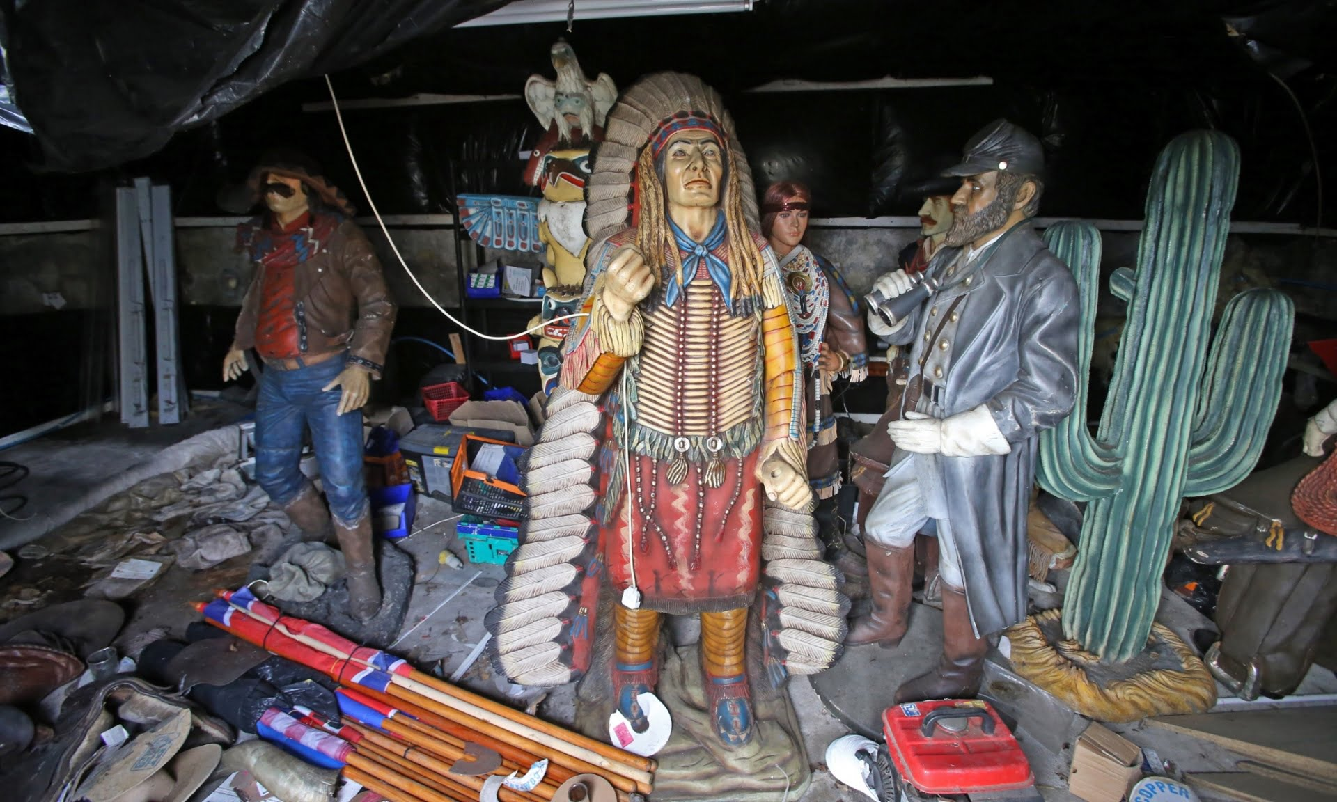 The hayshed is now a store for lifesize, painted wooden figures of cowboys and Indians.