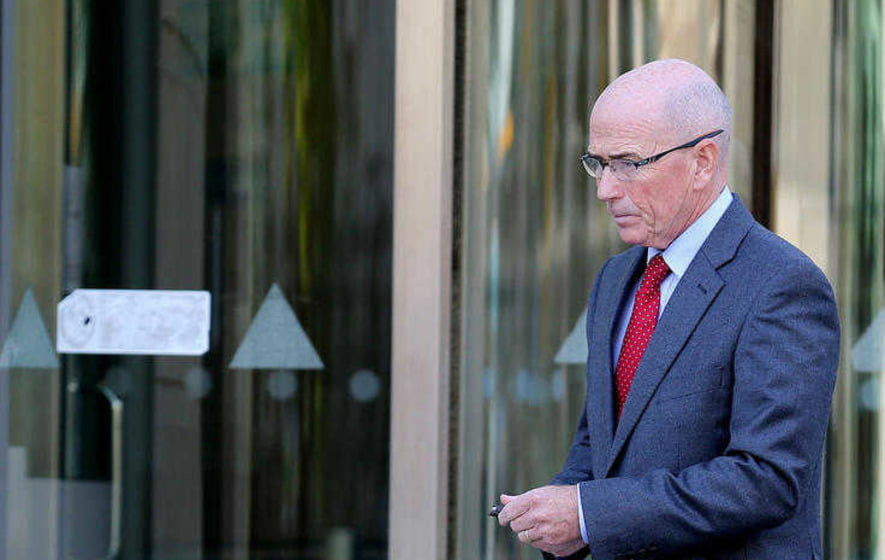 Former PSNI chief Roy Suitters leaves court in Belfast during the Daniel McColgan inquest. Picture by Hugh Russell