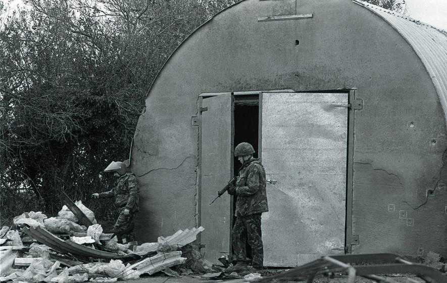 British soldiers examine the scene of the shooting at farm outbuildings near Loughgall, Co Armagh