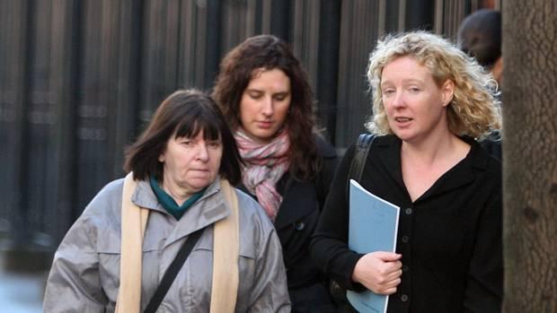Barrister Karen Quinlivan, right, with Pearse Jordan's mother Teresa, leaving the hearing in Belfast