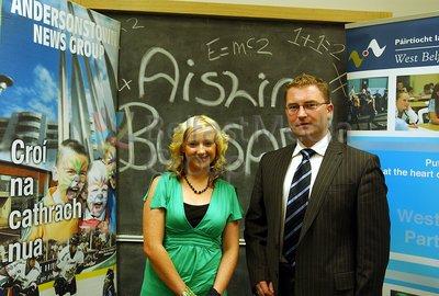 Ciaran Shiels presents Mairead Connolly with the Aisling Bursary