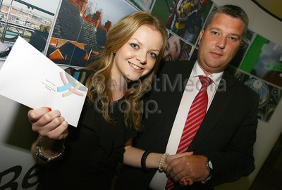 Fearghal Shiels presents Niamh Collins with the Aisling Bursary