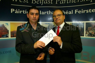Peter Madden presents Sean Pól Maginn, on behalf of his brother Emmett Maginn, with the Aisling Bursary