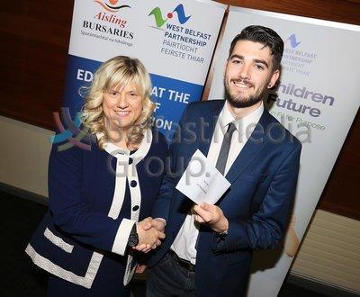 Roisin McKenna presents Darius Conlon with the Aisling Bursary