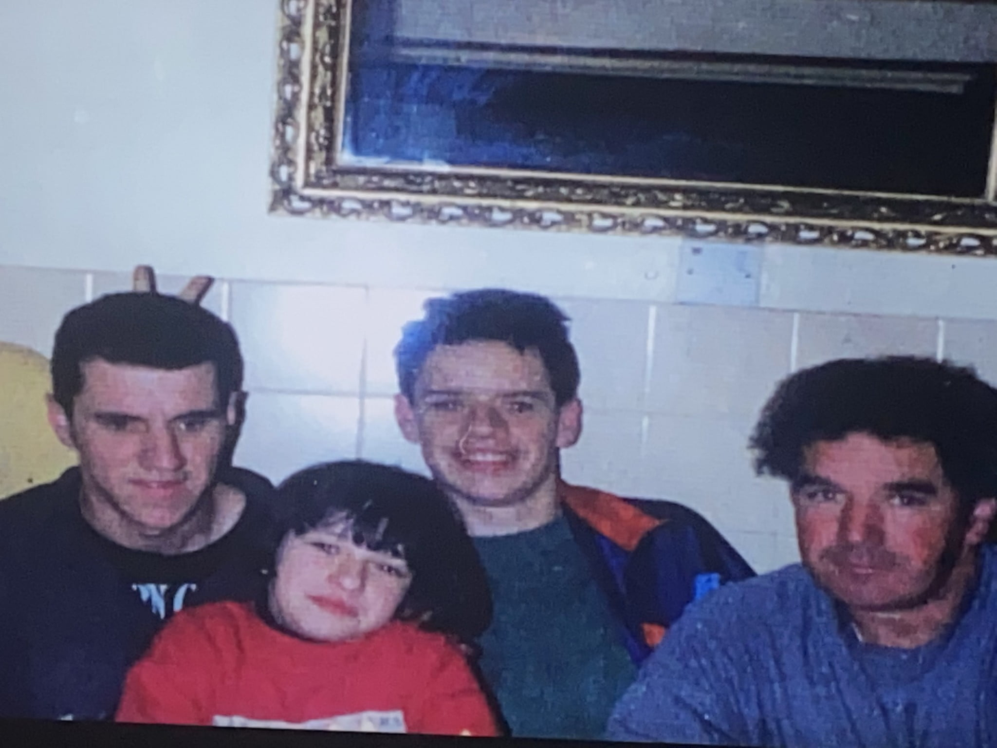 Gerard (22) and Rory Cairns (18) a couple of hours before they were shot, with their dad Eamon and sister Róisín who was celebrating her 11th birthday that day