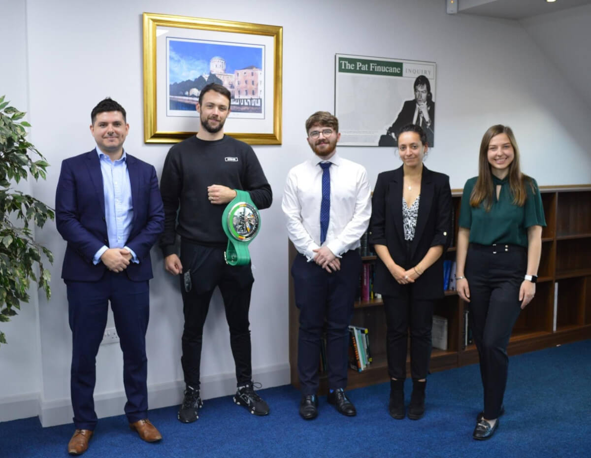Pictured with Pádraig Mc Crory at our Belfast office is Peadar Madden, Michael Murphy, Olga Martin and Francesca O'Hara of Madden & Finucane